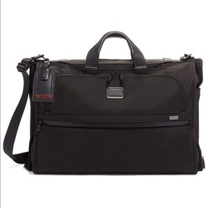 Tumi tri-fold garment bag, carry-on bag